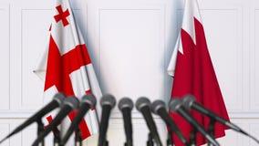 Drapeaux de la Géorgie et du Bahrain à la conférence de presse internationale de réunion ou de négociations animation 3D clips vidéos