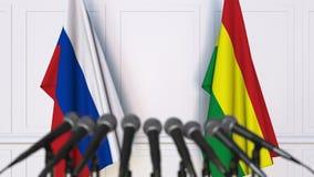 Drapeaux de la Russie et de la Bolivie ? la conf?rence de presse internationale de r?union ou de n?gociations animation 3D banque de vidéos