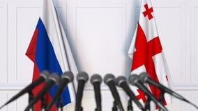 Drapeaux de la Russie et de la G?orgie ? la conf?rence de presse internationale de r?union ou de n?gociations animation 3D banque de vidéos