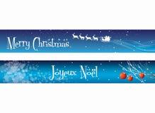 Drapeaux de Noël sur le bleu Images stock