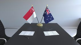 Drapeaux de Singapour et de l'Australie et papiers sur la table Négociations et signature d'un accord international illustration de vecteur