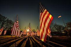 Drapeaux des Etats-Unis avec des ombres et l'éclat du soleil Images libres de droits