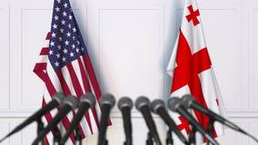 Drapeaux des Etats-Unis et de la Géorgie à la conférence de presse internationale de réunion ou de négociations animation 3D banque de vidéos