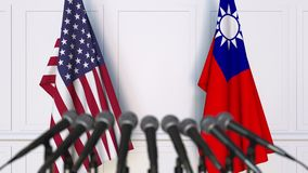 Drapeaux des Etats-Unis et de Ta?wan ? la conf?rence de presse internationale de r?union ou de n?gociations animation 3D banque de vidéos