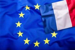 Drapeaux des Frances et de l'Union européenne Les Frances diminuent et l'UE diminuent Étoiles d'intérieur de drapeau Concept de d Photo libre de droits