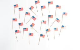 Drapeaux des USA sur un fond blanc Photographie stock