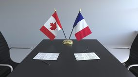 Drapeaux du Canada et de la France et papiers sur la table Négociations et signature d'un accord international 3D conceptuel illustration de vecteur