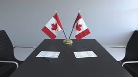 Drapeaux du Canada et des papiers sur la table Négociations et signature d'un accord Rendu 3d conceptuel illustration stock