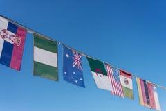 Drapeaux du monde sur une bannière Image libre de droits