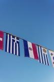 Drapeaux du monde sur une bannière Photos libres de droits