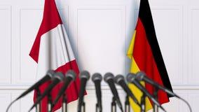 Drapeaux du Pérou et de l'Allemagne à la réunion ou à la conférence internationale rendu 3d Photographie stock libre de droits