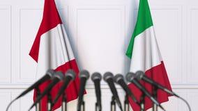 Drapeaux du Pérou et de l'Italie à la réunion ou à la conférence internationale rendu 3d Photographie stock