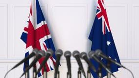 Drapeaux du Royaume-Uni et de l'Australie à la réunion ou à la conférence internationale rendu 3d illustration de vecteur