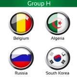 Drapeaux - le football Brésil, groupe H - la Belgique, Algérie, Russie, Corée du Sud Photographie stock libre de droits