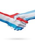 Drapeaux pays de luxembourgeois, Argentine, concept de poignée de main d'amitié d'association Photographie stock libre de droits