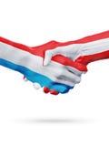 Drapeaux pays de luxembourgeois, Autriche, concept de poignée de main d'amitié d'association Images libres de droits