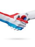 Drapeaux pays de luxembourgeois, Corée du Sud, concept de poignée de main d'amitié d'association Images libres de droits