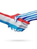 Drapeaux pays de luxembourgeois, Grèce, concept de poignée de main d'amitié d'association Photographie stock