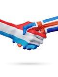 Drapeaux pays de luxembourgeois, Islande, concept de poignée de main d'amitié d'association Photographie stock libre de droits