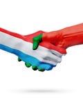 Drapeaux pays de luxembourgeois, Portugal, concept de poignée de main d'amitié d'association Image libre de droits