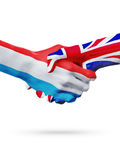Drapeaux pays de luxembourgeois, Royaume-Uni, concept de poignée de main d'amitié d'association Image libre de droits