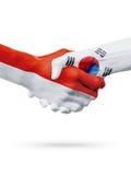 Drapeaux pays de Monaco, Corée du Sud, concept de poignée de main d'amitié d'association Photographie stock