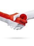 Drapeaux pays de Monaco, Japon, concept de poignée de main d'amitié d'association Photos stock