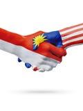 Drapeaux pays de Monaco, Malaisie, concept de poignée de main d'amitié d'association Images stock