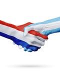 Drapeaux pays de Pays-Bas, Argentine, concept de poignée de main d'amitié d'association Images libres de droits