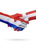 Drapeaux pays de Pays-Bas, Danemark, concept de poignée de main d'amitié d'association Images libres de droits