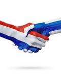 Drapeaux pays de Pays-Bas, Finlande, concept de poignée de main d'amitié d'association Images libres de droits