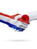 Drapeaux pays de Pays-Bas, Japon, concept de poignée de main d'amitié d'association Photo libre de droits