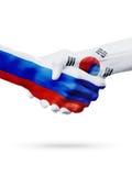Drapeaux pays de Russie, Corée du Sud, concept de poignée de main d'amitié d'association Image libre de droits