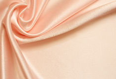 Draped background. Peach silk background with drapery in the corner Stock Photos