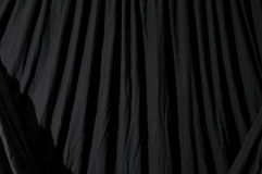 Draped black backdrop cloth Stock Photos