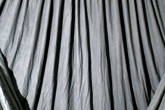 Draped black background cloth Stock Images