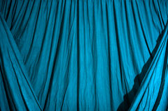 Draped black background cloth lit with blue gel Royalty Free Stock Photography