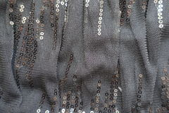 Draped black fabric with shiny paillettes. Draped black gauzy fabric with shiny paillettes Royalty Free Stock Image