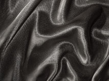 Draped black satin background Stock Photo
