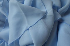 Draped chiffon cloth in pastel  blue color Royalty Free Stock Photography