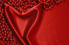 Draped in the form of heart with beads Stock Photos