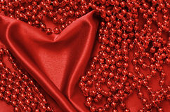 Draped in the form of heart with beads Royalty Free Stock Photo