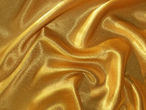 Draped golden (orange) satin background Stock Image