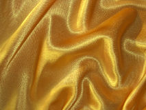 Draped golden (yellow) satin fabric Stock Images
