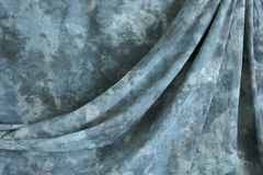 Draped mottled grey background Royalty Free Stock Images