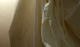 Draped muslin background cloth with wall Royalty Free Stock Image