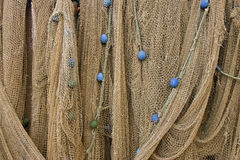 Draped Nets. Hand made fishing net with floats Stock Photo