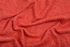 Draped orange tweed wool fabric texture royalty free stock photography