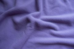 Draped violet fleece fabric from above. Draped pale violet fleece fabric from above Royalty Free Stock Images