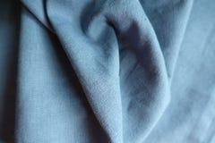 Draped pastel blue unprinted linen fabric. Draped pastel blue simple unprinted linen fabric Stock Photos